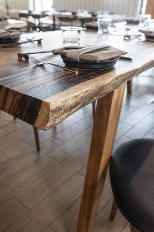 acacia wood dining table at Kojo